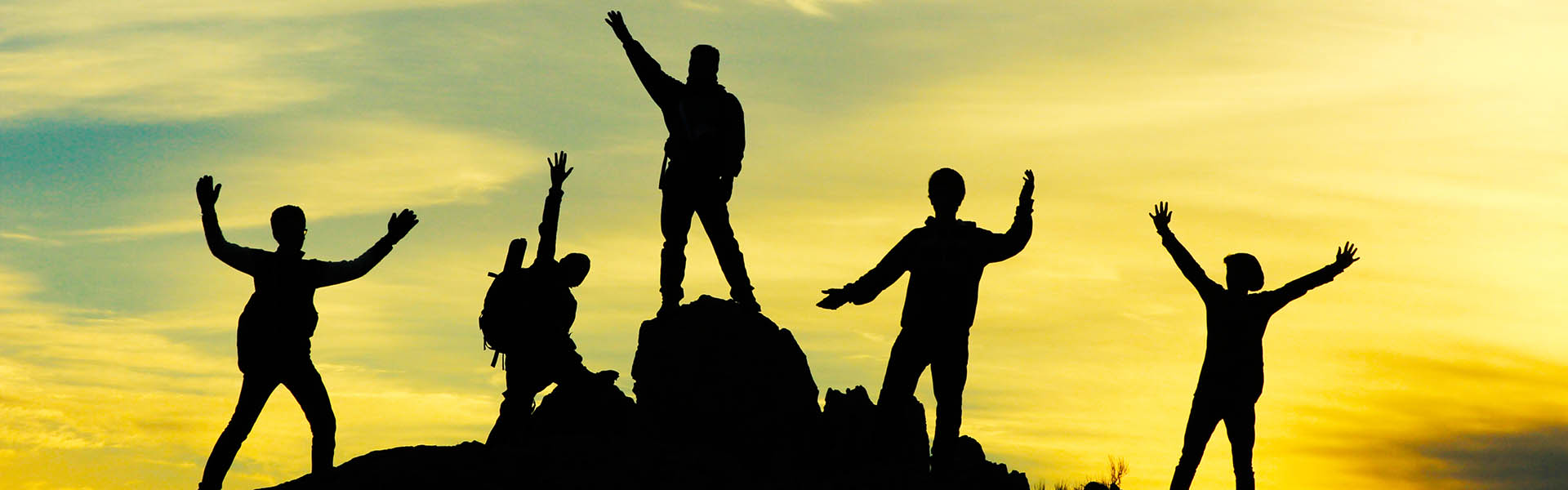 5 silhouettes on top of mountain