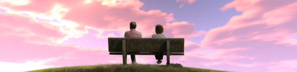 two people on a bench enjoying a sunset